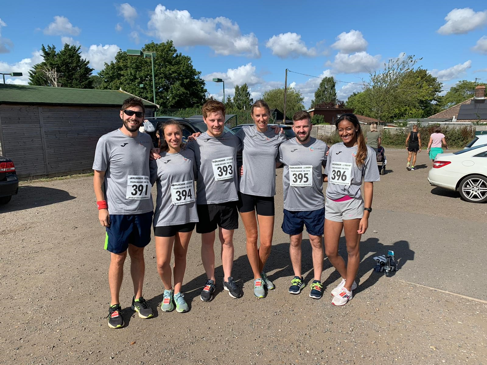 Group picture of Conrad runners before taking part in the 10k
